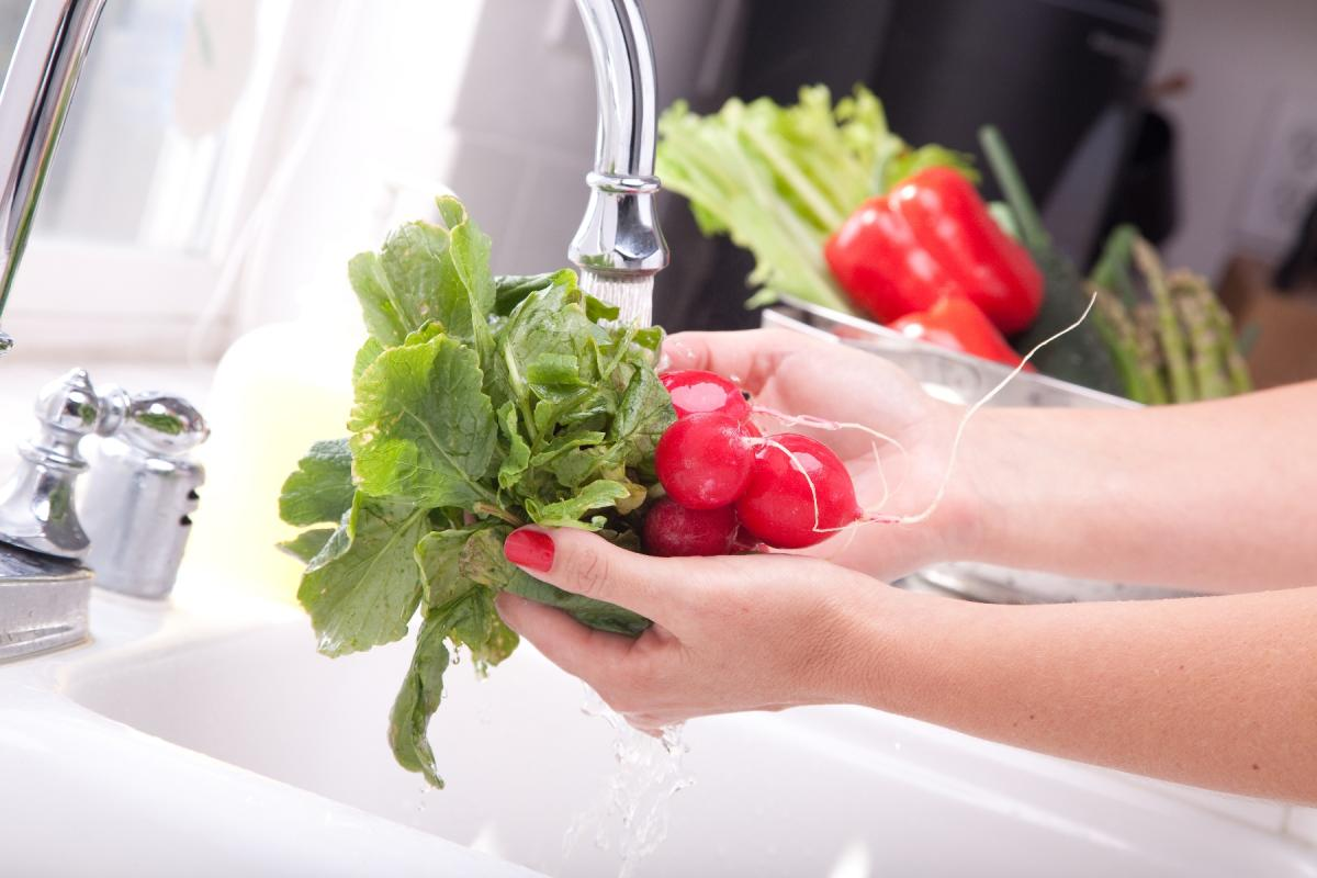 Washing veggies in the kitchen sink
