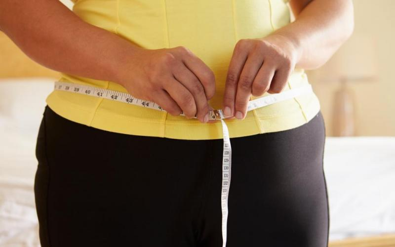Photo of woman measuring her midsection