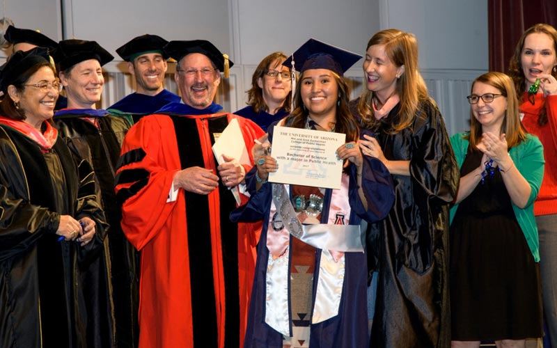 Kennedy Showtalker (center) is the 1,000th student to graduate from the Bachelor of Science in Public Health program.