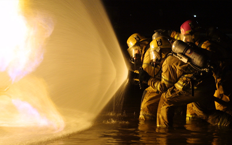 Photo of firefighters fighting fire. Photo credit: Tucson Fire Department