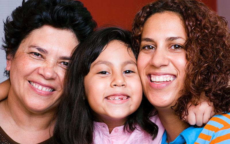 Three generations of latinas together smiling