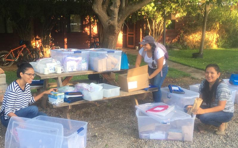Organizing field sampling materials for the community health representatives from the Navajo Department of Health in Aneth, Utah. From left: Rachelle Begay, Yoshira Ornelas Van Horne and Corinna Sabaque, a MPH student from the UA College of Public Health.