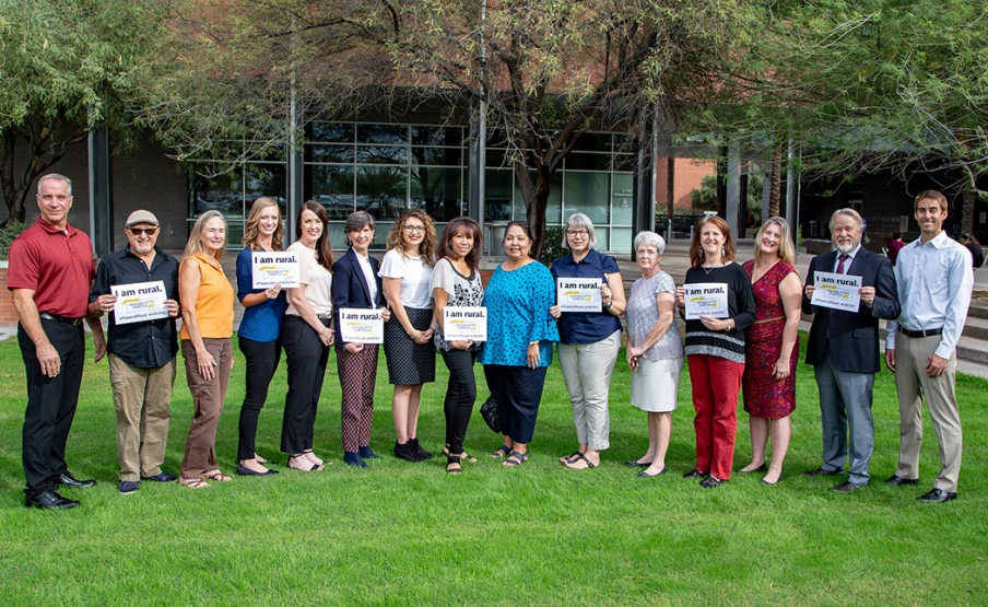 Faculty and staff of the Center for Rural Health at the UA Mel and Enid Zuckerman College of Public Health. From Left, Rod Gorrell, Paul Akmajian, Susan Coates, Amy McPherson, Melissa Quezada, Joyce Hospodar, Melissa Quezada, Rebecca Ruiz, Agnes Attakai, Jennifer Peters, Sharon Van Skiver, Jill Bullock, Hillary Evans, Daniel Derksen, and Marc Verhougstraete. Other staff missing from the photo: Heather Carter and Alyssa Padilla.