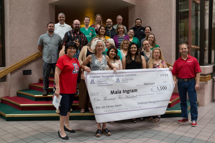 Maia Ingram (center) with faculty and staff of the UA Mel and Enid Zuckerman College of Public Health and members of the Arizona Prevention Research Center Community Action Board, received the UA Billy Joe Varney Award for Excellence.