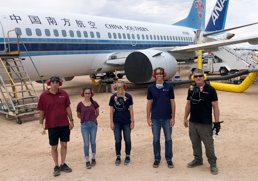 Marc Verhougstraete (fourth from left) and students at Pima Air and Space Museum