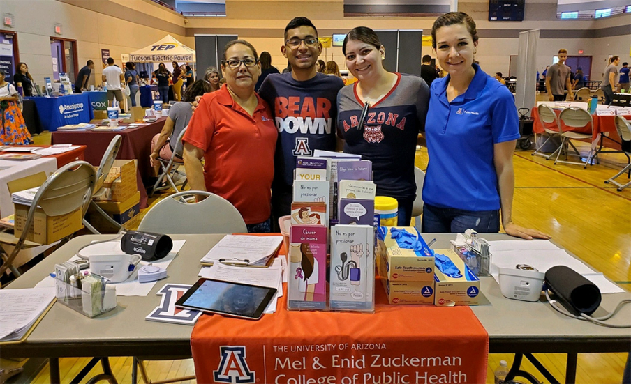 Andrea Contreras (promotora), Eddie Vargas (student) and community volunteers Tanya Gonzalez and Tania Felix at the Arizona Bilingual Annual Back to School event, July 2019. Before the pandemic, MHU team members engaged with the community in person. (Photo: Sheila Soto/University of Arizona)