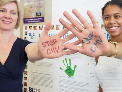 From left; Dr. Felicia Goodrum and public health student Bre Eder join hands to educate the public about the cytomegalovirus (CMV) virus.