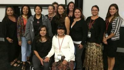 From left (seated) Carmella Kahn-Thornbrugh and Priscilla Sanderson; (middle) Agnes Attakai, Octaviana Trujillo, Athena Crozier, Nicolette Teufel-Shone, Stephanie Carroll Raine, Tara Chico, Christina Oré de Boehm, Aurora Trujillo; (Back): Sheena Brown, Michele Henson