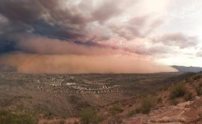 A haboob, or dust storm, blowing into Ahwatukee, near Phoenix, as seen from the top of South Mountain, looking south on July 23, 2011. Notice the size of homes in the foreground.