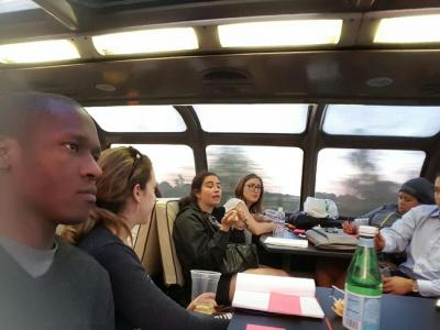 Christian Mpody (left) with fellow travelors aboard the Millennial Train.