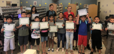 The first graduating class of the Saludable program at the Aguila Library in Maricopa County, Arizona in August. The six-week prevention and intervention program for children ages 8-13 is part of a pilot study by researchers at the UA Mel and Enid Zuckerman College of Public Health, teaching Latino students how to manage toxic stress using mindfulness techniques to prevent obesity.