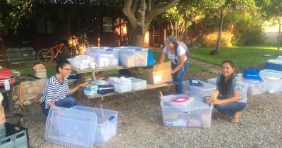 Investigators from the UA College of Public Health organize field sampling materials to test drinking water, soil and dust in Aneth, Utah. From left: Rachelle Begay, Yoshira Ornelas Van Horne and Corinna Sabaque (MPH student).
